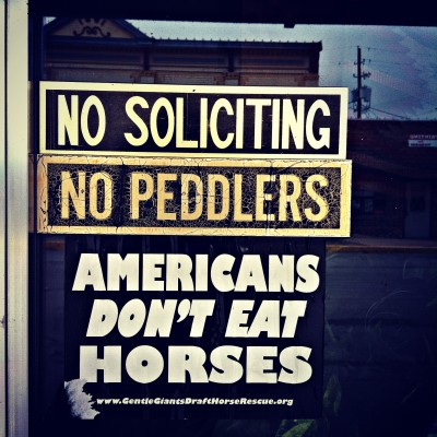 A sign on a shop door in the old town square in Brenham, Texas