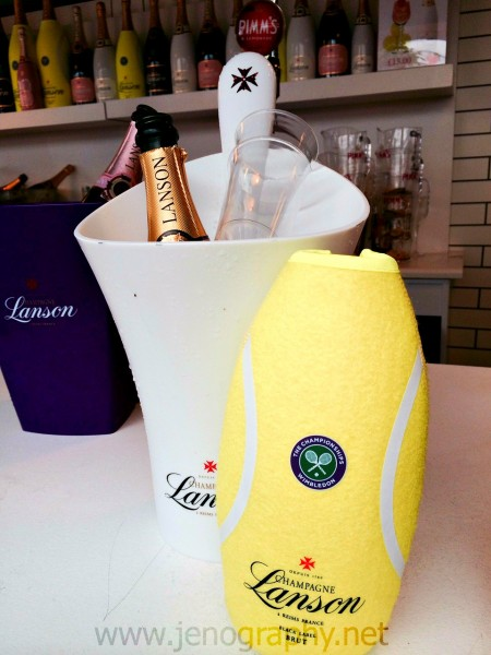 """The bottles of Lanson Champagne came with these """"tennis ball"""" wraps (in Texas we call them coozies)"""