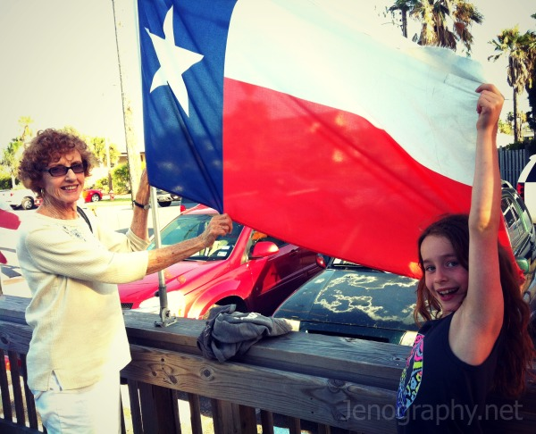 grandmother and girl with Texas flag