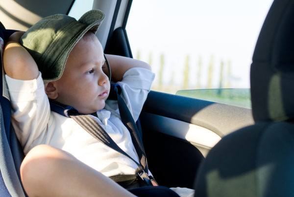 boy in car, via Shutterstock