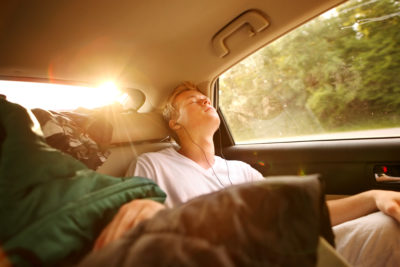 teen sleeping in car via Shutterstock