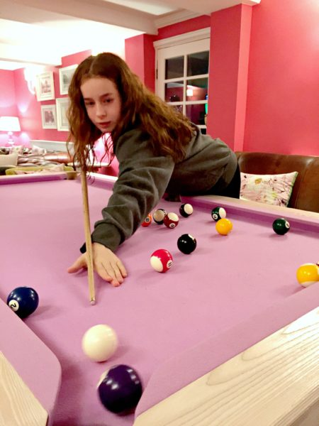 playing on the pink pool table at The Swan Hotel