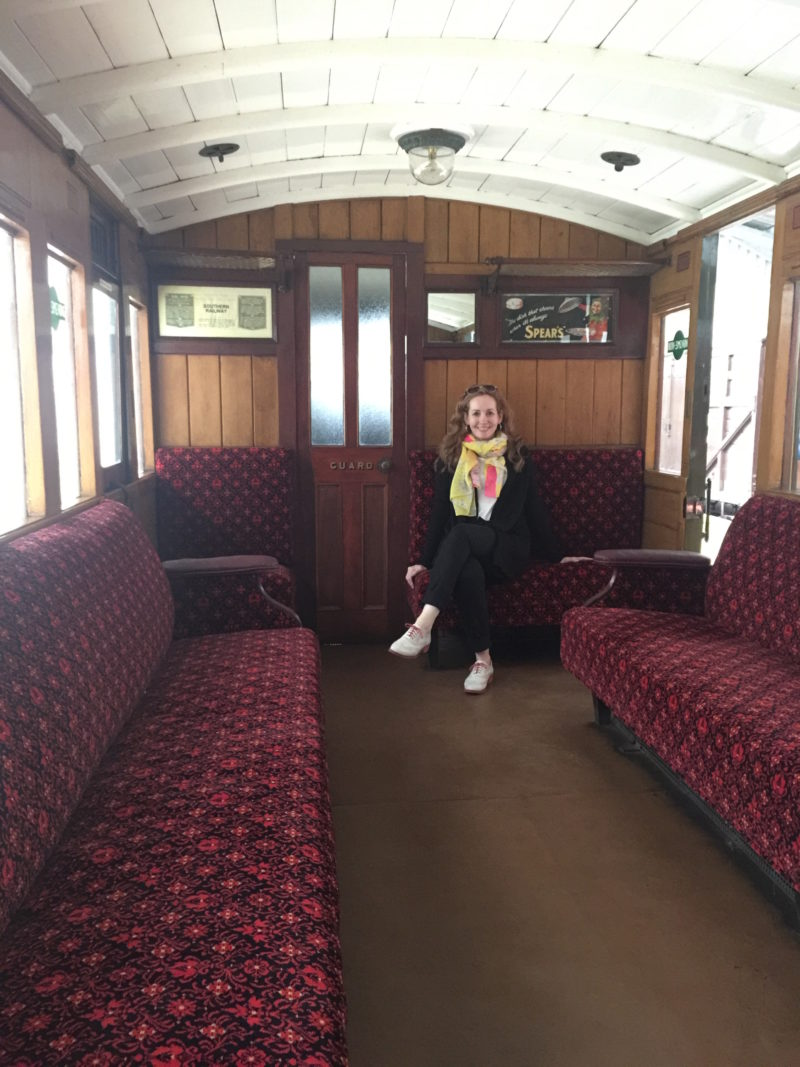 sitting in restored carriage