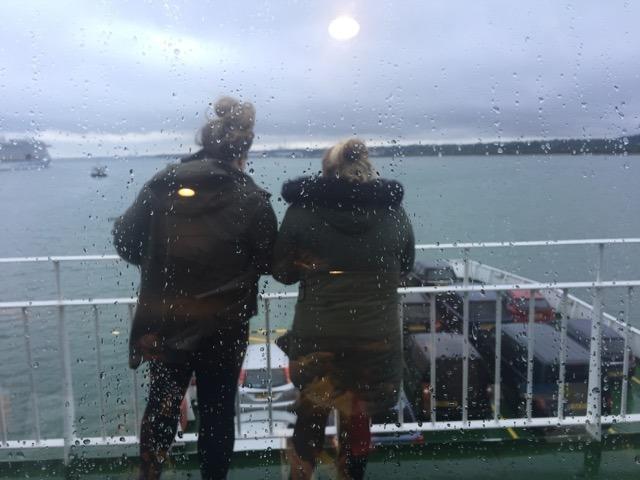 women on ferry deck