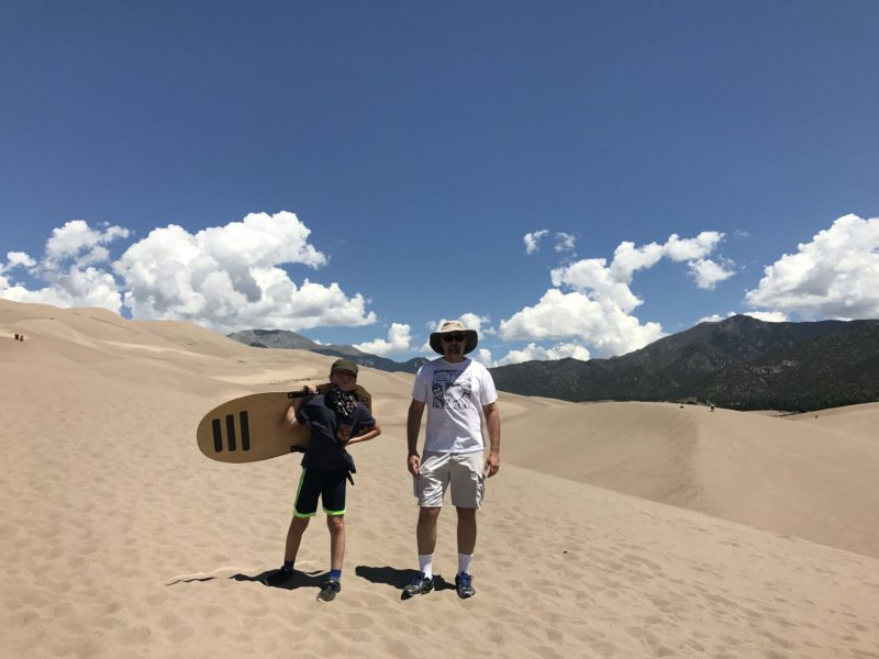 boy and dad on sand dunes